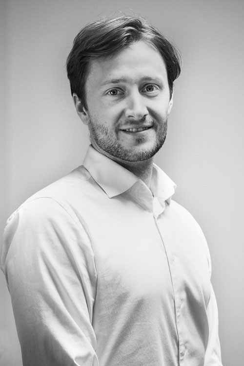Portrait of Gture's senior project manager Marius fekene
