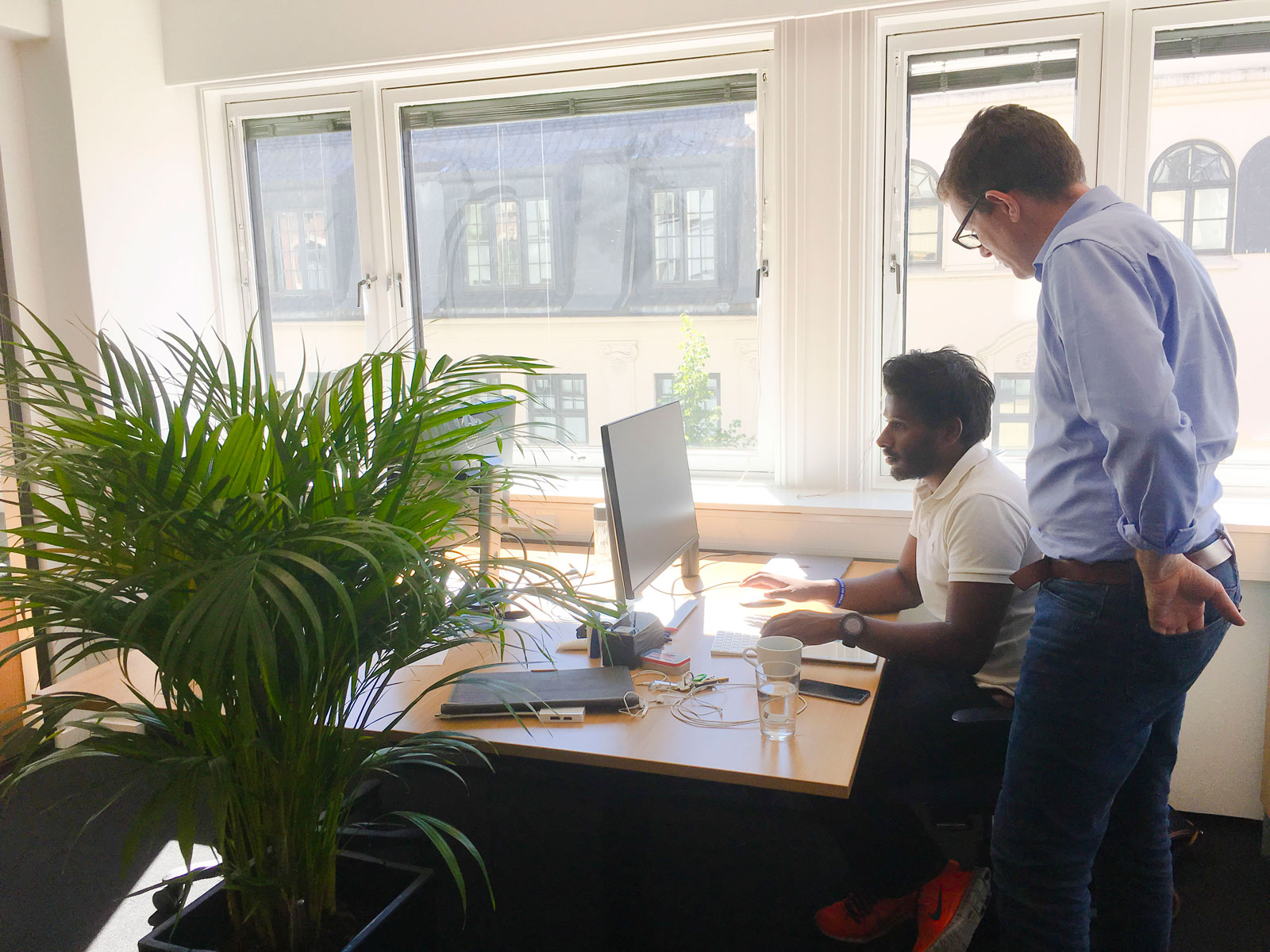 Two Gture employees working with digital transformation in the Gture office